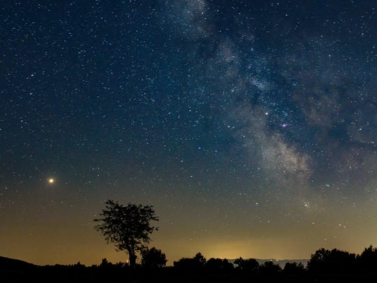 Mars, left, and the Milky Way are visible in the clear night sky as photographed near Salgotarjan, Hungary, on Aug. 3, 2018.