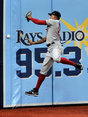 Boston Red Sox left fielder Yairo Munoz can't reach a double off the wall hit by Tampa Bay Rays' Ji-Man Choi during the first inning of a baseball game Saturday, Sept. 12, 2020, in St. Petersburg, Fla.