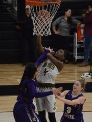 Abilene High's Maya Taylor goes up for a layup over