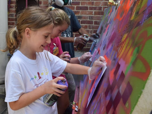 ANI River Oaks Camp Amber Sealey (front) and Noelle Corley spray paint designs in a street art/graffiti class they are taking at a summer art camp held at River Oaks Art Center Tuesday, July 7, 2015. The class is taught by Pat Phillips.-Melinda Martinez/Th