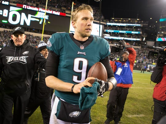Eagles quarterback Nick Foles walks towards the tunnel back to the locker room after the Eagles defeated the Falcons 15-10 Sunday at Lincoln Financial Field.
