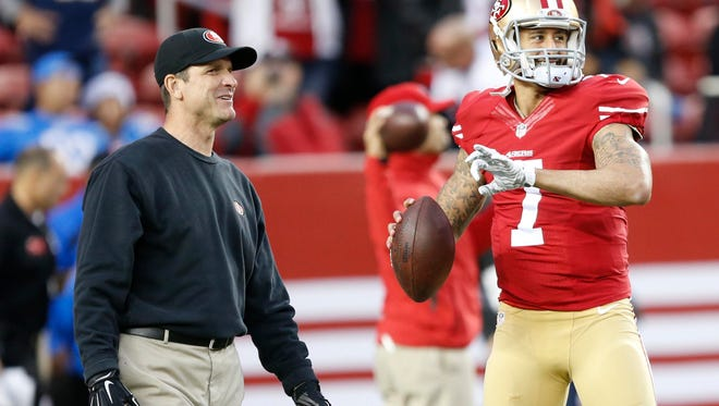 San Francisco 49ers coach Jim Harbaugh, left, and quarterback Colin Kaepernick get ready for a game against the San Diego Chargers.