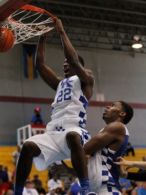 Bahamas16:  University of Kentucky junior Alex Poythress dunks against the Puerto Rico national team at the Big Blue Bahamas tour in Nassau, Bahamas, August 10, 2014. Drew Fritz/Special to the Courier-Journal