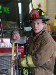 Brewster firefighter Mike Larm on duty at  Brewster fire station1 Feb. 5, 2016. Lara is also a wrestler for Brewster high school.