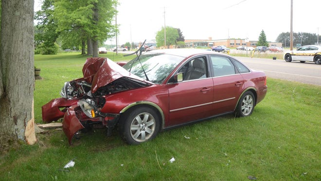 Police said this car was driven into a tree after it hit a girl in traffic on Pennfield Road.