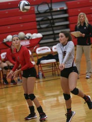 Crestview's Kennedy Hickey hits the ball during a match