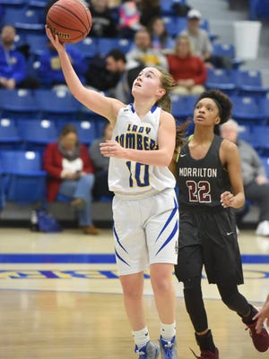 Mountain Home's Payton Huskey (10) goes up for two during the Lady Bombers' 54-31 victory over Morrilton on Friday night.