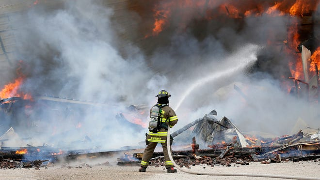 Multiple fire departments battle a fire on Amy Ave. Tuesday, April 19, 2016 in the Town of Harrison, Wis.  Wm. Glasheen/USA TODAY NETWORK-Wisconsin