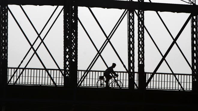 A cyclist rides into Kentucky on the John A. Roebling Suspension Bridge from Smale Park. With so many connections or proximity to other trails, it's a great place to start – or end – a ride.