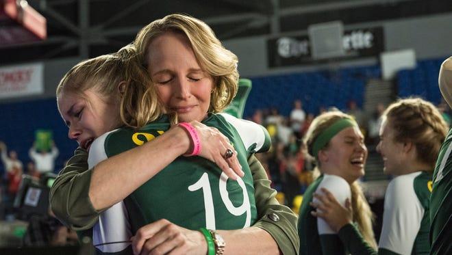 "Coach Kathy (Helen Hunt) hugs Kelley (Erin Moriarty) in ""The Miracle Season."""