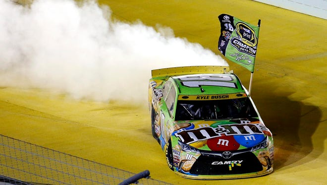 Kyle Busch celebrates after winning the 2015 NASCAR Sprint Cup Championship at Homestead-Miami Speedway.