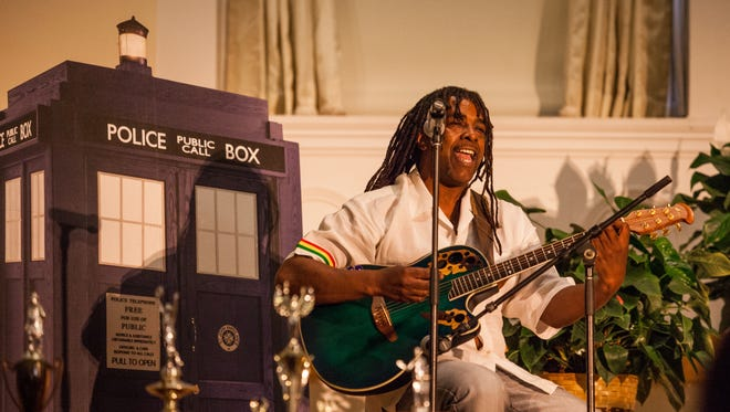 """Bobby Hackney performs Bob Marley's """"Redemption Song"""" at Friday's memorial service for Alfred """"Tuna"""" Snider at the Ira Allen Chapel at the University of Vermont."""
