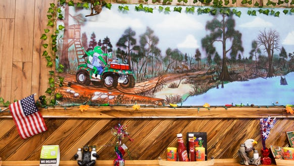 A mural in the dining area at Cajun Works in Breaux