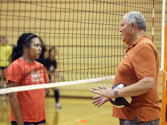 Gordy Bushaw, right, offers instruction to Central Kitsap volleyball player Asha Hill in 2010. Bushaw, already a member of the state volleyball hall of fame, will be inducted next year into the Kitsap sports hall of fame.