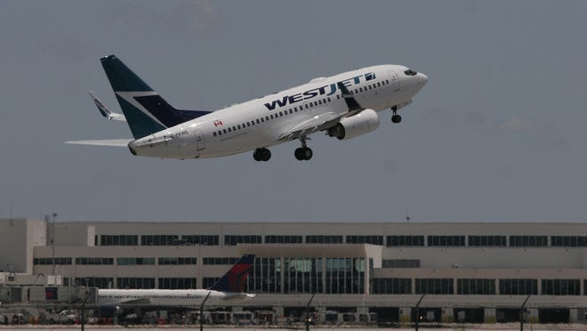 A WestJet aircraft takes off from RSW. So far, no new disease-related marching orders have come down for Florida airports.