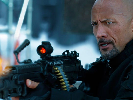 """Dwayne Johnson shoots 'em up in """"The Fate of the Furious."""""""