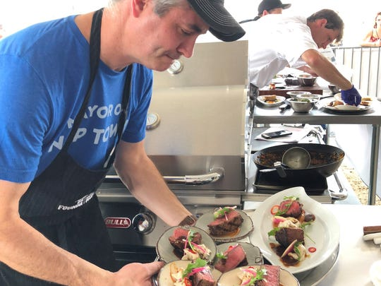Indianapolis chef Criag Baker readies steak oscar in the second round of a World Food Championships semi-final contest Nov. 11, 2017, in Orange Beach, Ala.