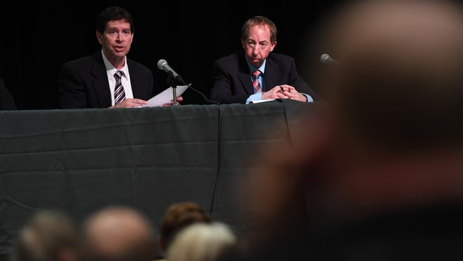 Anthony Fontana, left, and Tom Byrne of the Department of Environmental Protection hear public comments Thursday on Waste Management's permit renewal application to operate a waste transfer site in Hillsdale.
