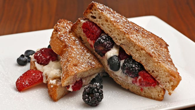Stuffed French toast with lemon cream cheese and fresh berries from executive sous chef Justin Pfeilsticker at ZuZu, Hotel Valley Ho.