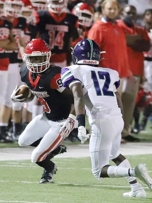 Northside's Tyheen Prosise looks to turn up field past Little Rock Southwest on Nov. 6 at Mayo-Thompson Stadium in Fort Smith.