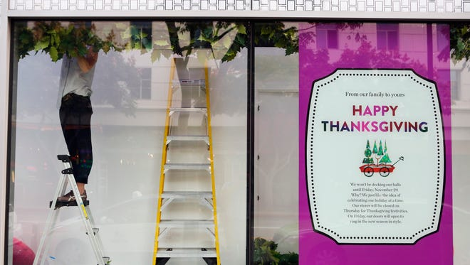 A Nordstrom department store in Santa Monica, Calif., displays a sign in its window explaining why the retailer is bucking the national trend to open on Thanksgiving.