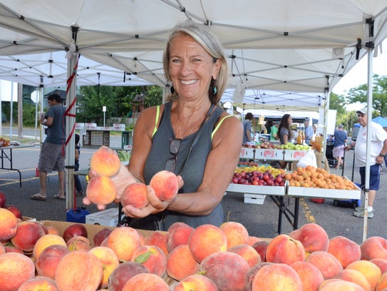 Nancy Boone, Manger at the Ramsey Farmers Market, holding