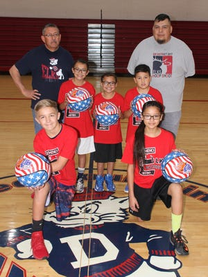 The Benevolent and Protective Order of the Elks, Deming Lodge 2750, held is annual community-wide Hoop Shoot Contest on Saturday, Dec. 2, at the Red Mountain Middle School gymnasium. The contests included boys and girls, ages 8-13, in a free throw shootout to determine winners who will have the opportunity to move on to a district-wide competition and advance to state, regional and national formats. Saturday's winners were, standing from left, Bianca Pacheco, 11; Bella Pacheco, 9; and Noah Holguin, 9. Kneeling from left areRiley Apodaca, 11, and Nayeli Jimenez, 12. Standing at far leftis Deming Elks Exalted Ruler George Torres and at far right is Deming Elks Hoop Shoot Director Ernie Arrey. Deming will also be the site of the district-wide shootout on January 13, 2018 at RMMS.