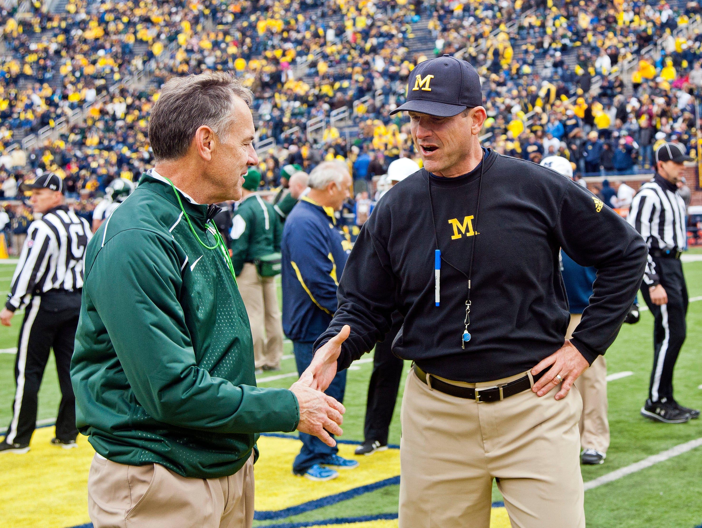 Michigan State coach Mark Dantonio shakes hands with Michigan coach Jim Harbaugh at Michigan Stadium on Oct. 17.