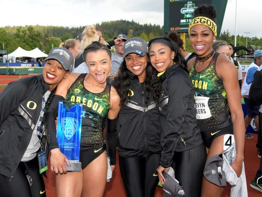 Members of the Oregon Ducks womens team pose after winning their ninth consecutive conference title during the Pac-12 Championships at Hayward Field. From left are Elexis Guster and Ashante Horsley and Alaysha Johnson and Raeven Rogers.
