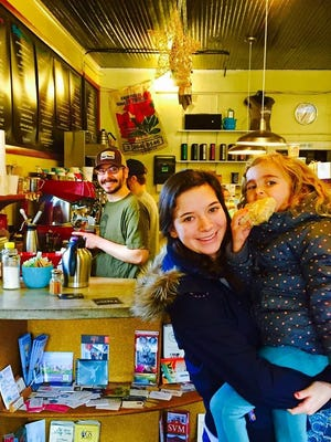 Vince Bahorik, behind the bar, made a lot of friends at the Dripolator, including Madison Walker and Lauren Tressler, in Walker's arms.