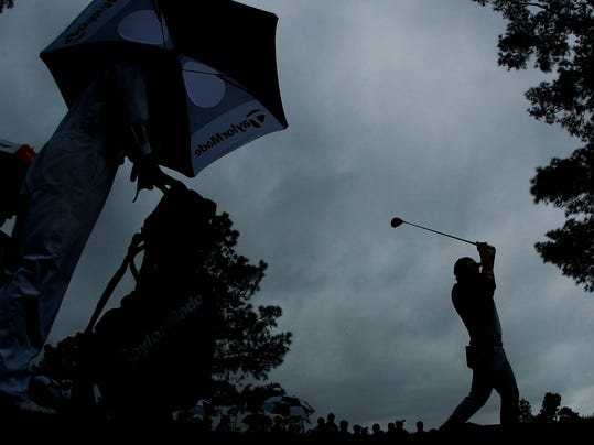 Jon Rahm, of Spain, hits a drive on the 18th hole during the third round at the Masters golf tournament Saturday, April 7, 2018, in Augusta, Ga. (AP Photo/Charlie Riedel)