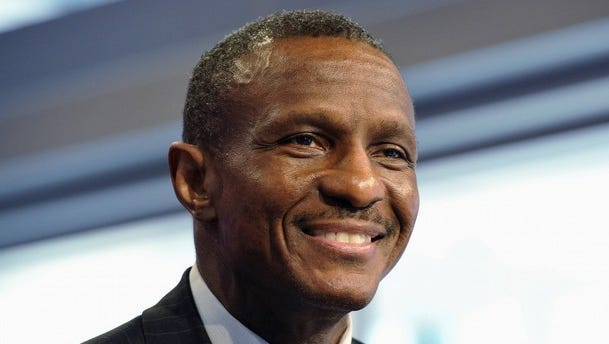 Dwane Casey, pictured in 2011, smiles after being introduced as the head coach of the Toronto Raptors.  REUTERS/Mike Cassese (CANADA - Tags: SPORT BASKETBALL PROFILE)