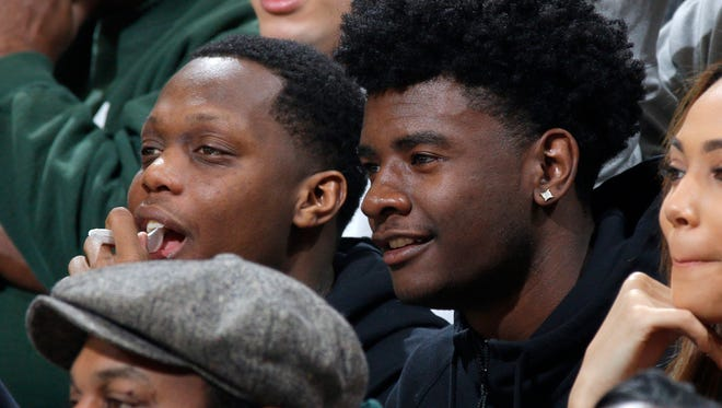 Josh Jackson and Cassius Winston watch MSU play Ohio State at the Breslin Center on March 5.