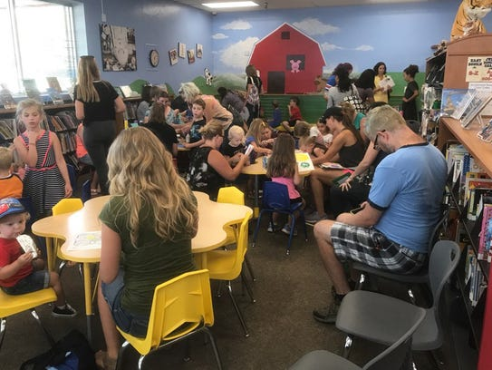 Children and teens crowd into the Yorktown Public Library
