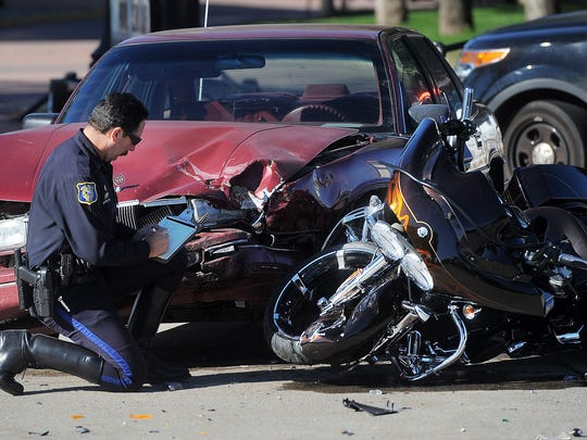 A Sioux Falls Police officer documents the fatal accident at Westbrooke Lane and 41st Street on Sunday, August 23, 2015.