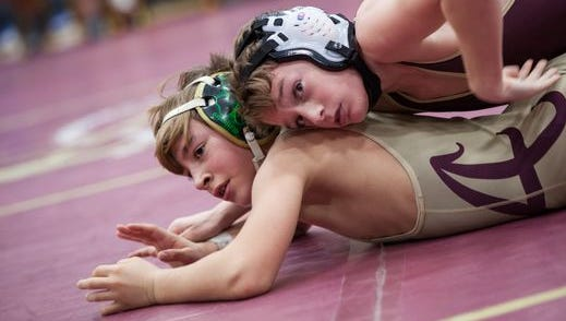 Tim Bova and Dennis Robin of Arlington High School face off for the 99 pound match champion title at the 51st Annual Mid-Hudson Wrestling Invitational at Arlington High School in Langrangeville, December 28, 2016