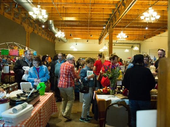 Visitors to the Home Grown show walk through vendors set up in the New Mexico Farm and Ranch Heritage Museum exhibit halls with vendors selling crafts and other goods along with some food vendors at the 2016 Home Grown show at the Farm and Ranch Museum. Saturday November 19, 2016.