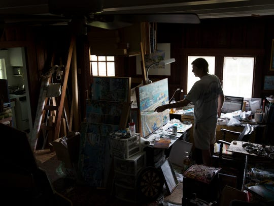 Artist Paul Arsenault paints a scene of Marco Island in his home studio Monday, Sept. 4, 2017, in downtown Naples. The United Arts Council surveyed more than 800 people to be part of the national assessment of The Arts and Prosperity. The results will be discussed at a public forum Wednesday at the Naples Daily News.