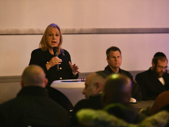 Council Woman Valerie Huttle speaks to participants