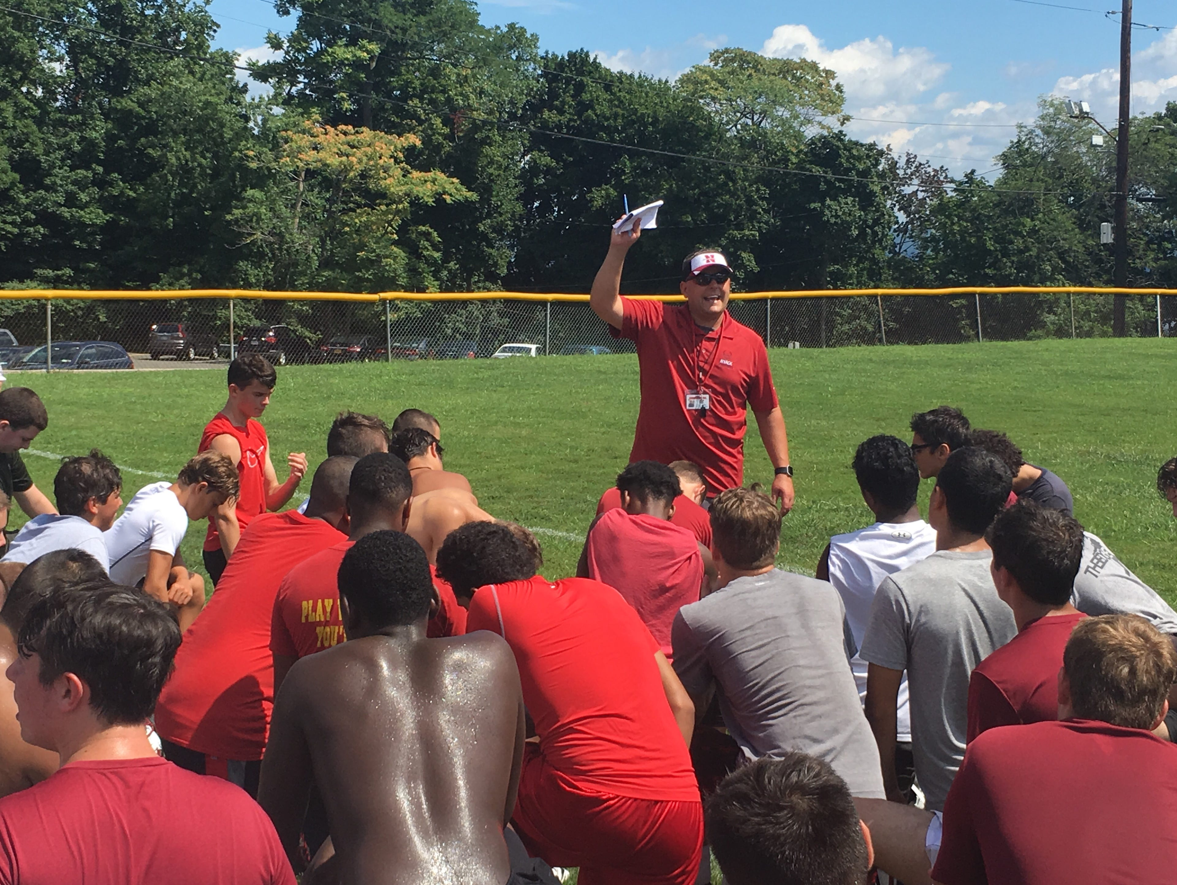 New Nyack football coach Dominick DeMatteo meets with players at the end of their first practice of 2016. At Nyack MS. DeMatteo, who coached nine seasons at Arlington, is the son of Tony DeMatteo, Section 1's all-time winningest coach.