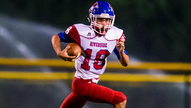 Riverside quarterback Logan DiBenedetto rushed for 66 yards and passed for 76 yards in the Warriors' 21-13 win at Travelers Rest Friday night.