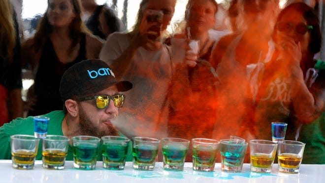 Bartender Justin Hulen of O'Riley's Irish Pub sets his drink on fire during the Flair Round of the Fish House Barlympics Sunday, August 6, 2017 at the Fish House.