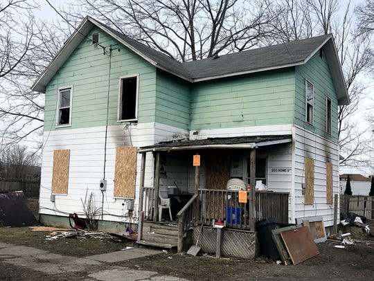 Three people died Saturday night when a blaze erupted