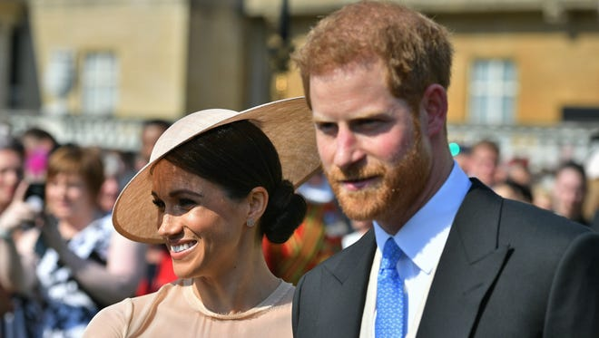 Prince Harry Duke of Sussex and his bride, Duchess Meghan of Sussex at a garden party at Buckingham Palace on May 22, 2018, in their first royal engagement as a married couple.