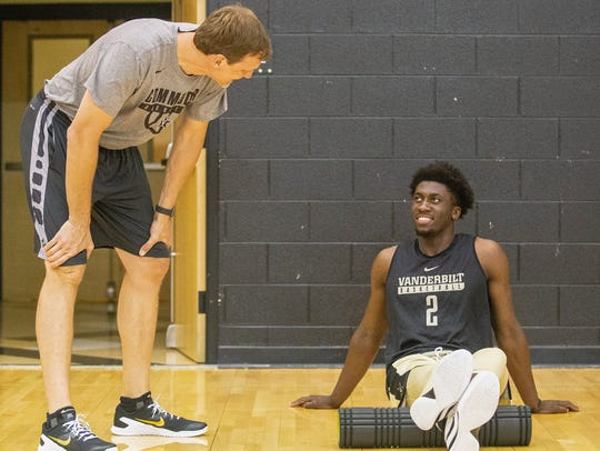 Vanderbilt assistant coach Casey Shaw talks with Simi Shittu during summer workouts. Shaw has taken the head coaching job at Davidson Academy.