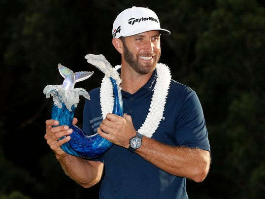Dustin Johnson with Sentry ToC trophy