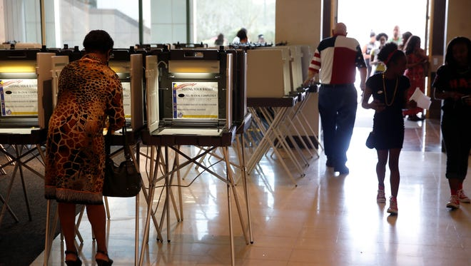 People vote at the Leon County Courthouse downtown during Florida's primary election on Tuesday, March 15, 2016.