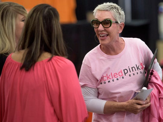 Joy Blondheim, of Joy to Life, chats at the Tickled Pink Woman's Expo at the Multiplex at Cramton Bowl in Montgomery, Ala., on Friday September 30, 2016.