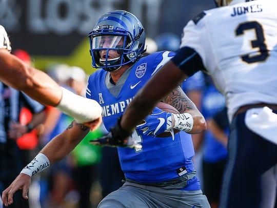University of Memphis quarterback Riley Ferguson looks for positive yards against the Navy defense during second quarter action Liberty Bowl Memorial Stadium in Memphis, Tenn., Saturday, October 14, 2017.