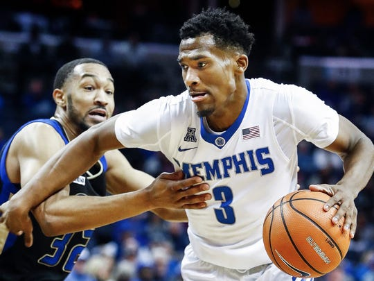 Memphis guard Jeremiah Martin, right, drives the lane